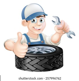 Auto mechanic giving thumbs up with a spanner and auto-mobile vehicle tyre