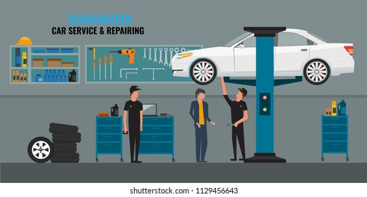 Auto repair shop interior with mechanics or masters working and fixing cars, professional service concept and talking to a client. Car on the lift. Tools panel on wall.