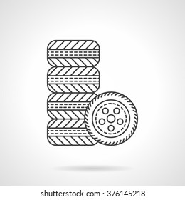 Automobile tires. Kit of car wheels. Car services. Shop for auto spare parts. Vector icon flat thin line style. Element for web design, business, mobile app.