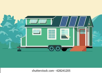 Autonomous tiny house on nature. Small house with solar panels on the roof.