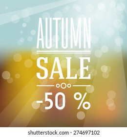 Autumn abstract sale label with blurred background.