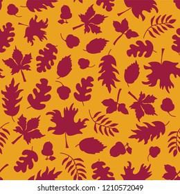 Autumn background. Fall leaves seamless vector pattern. Dark pink leaf silhouettes on orange. Acorns, oak tree, maple tree pattern. Fall background, Thanksgiving card, Seasonal prints, November, paper