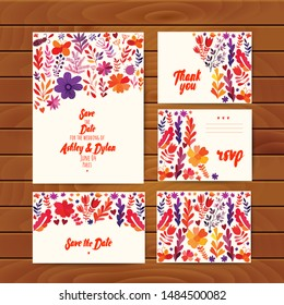 Autumn flowers wedding cards set with folk ethnic flowers, bright ornamental plants and branches on wood background. Autumn flowers for invitation, wedding or banners