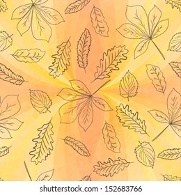 Autumn leaves seamless pattern on geometric background