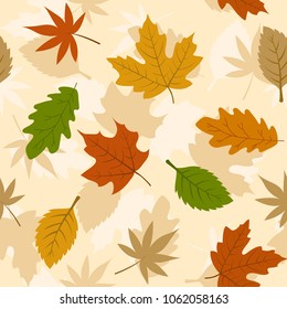 Autumn leaves seamless pattern. Scattered colorful yellow, green and orange leaves pattern