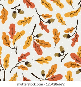 Autumn oak leaves with acorns on the branches. Seamless vector pattern design for  seasons greeting cards or gift wrap paper.