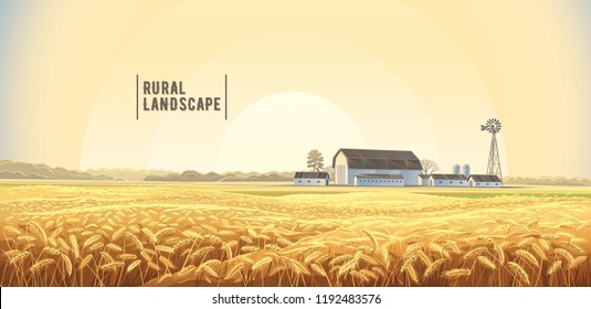 Autumn rural landscape with wheat field on the foreground and farm, on the back plan.