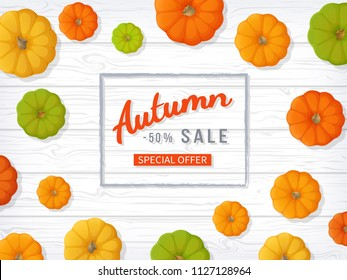 Autumn sale background. Horizontal banner flyer in a rectangular frame with colored pumpkins on a white wooden table. Special seasonal offer, discount.  Vector illustration. Top view