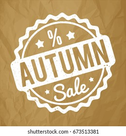 Autumn Sale rubber stamp white on a crumpled paper brown background.