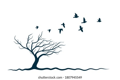 Autumn tree with flying birds.