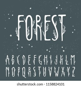 Autumn vector alphabet. Uppercase letters decorated with tree branches.