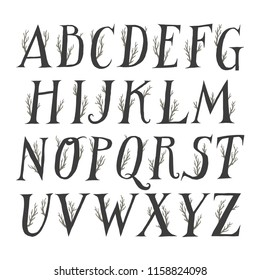 Autumn vector alphabet. Uppercase serif letters decorated with tree branches.