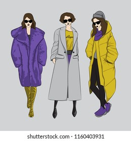 Autumn-Winter Coats Fashion Trend. Three women fashion sketch. Vector illustration. Eps 10.