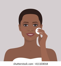 Avatar portrait of beautiful african american woman cleaning her face with cotton pad. Vector illustration. Smiling girl. Beauty and health. Flat design.