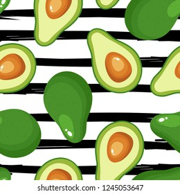 Avocado seamless pattern for textiles, prints, clothing, scrapbooking, banner and more. Ripe vegetables on striped background. Healthy food print. Can be used for textile, kitchen, scrapbooking.