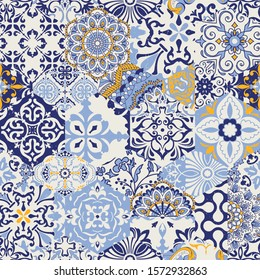 Azulejos tiles patchwork. Seamless colorful patchwork. Hand drawn seamless abstract pattern. Majolica pottery tile, blue, yellow azulejo. Original traditional Portuguese and Spain decor. Vector