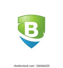 B initial swoosh shield logo blue green