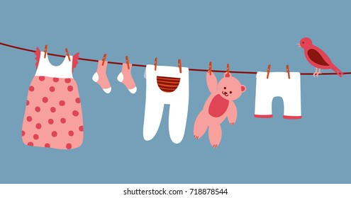 baby clothes hanging on a clothesline dry and clean; socks, a dress, shorts, a teddy bear and a sitting bird; a vector cartoon flat illustration