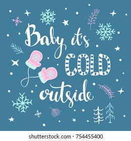 Baby its cold ouside handwritten and hand drawn typographic poster with winter christmas decoration, mittens,snowflakes, frozen twigs and branches, snow
