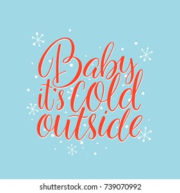 Baby, it's cold outside. Hand drawn holiday lettering with snowflakes on a blue background