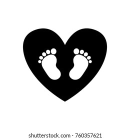 Baby footprints inside of black heart icon isolated on white background. Black and white vector illustration, logo, icon.