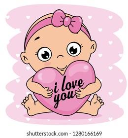 baby girl hugging a heart