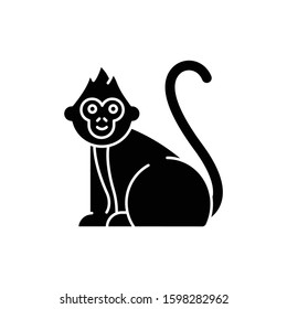 Baby monkey glyph icon. Tropical country animal, mammal. Exploring Indonesian islands wildlife. Cute primate sitting. Silhouette symbol. Negative space. Vector isolated illustration
