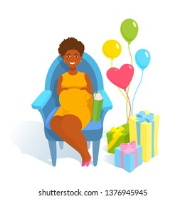 Baby shower. Beautiful pregnant happy young woman in yellow dress holding hands on her belly, smiling. Cute smile, happiness. Gift boxes, bag, balloons, armchair. Expecting future parenthood.