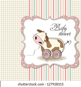 Baby shower card with cute cow toy, vector illustration