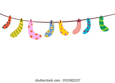 Baby socks on a rope. Set of children's socks are dried on a rope. Bright vector socks hanging on a rope. Cute clothes.