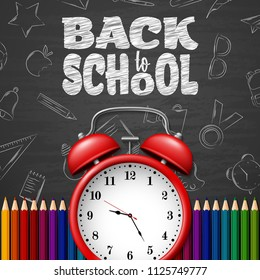 Back to school background with doodle elements on chalkboard, alarm clock and colorful pencils