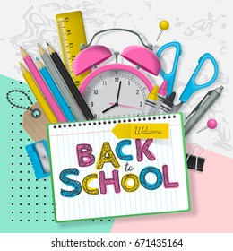 Back to school banner design with lettering and school supplies. Flat lay style