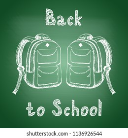 Back to school - chalk drawing of two school backpacks on a green school board. Back to school concept. Design element for flyer or banner. Hand drawn sketch. Vector illustration