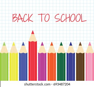 Back to school. A set of colored pencils on a background of notebook sheet in a cage.