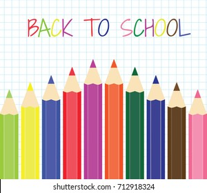 Back to school. A set of colored pencils on a background of notebook sheet in a cage