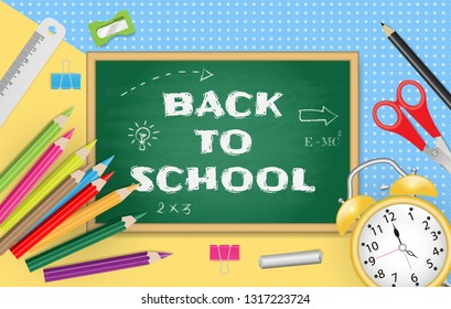 Back to school text on chalkboard with school supplies on colorful paper background