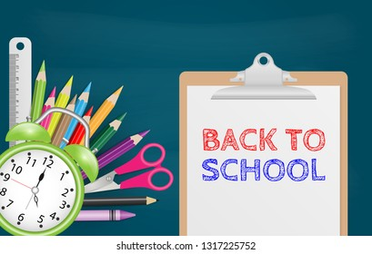 Back to school text on white sheet on clipboard with school supplies on chalkboard background