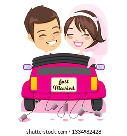 Back view of happy just married couple riding on pink car with cans attached enjoying wedding day