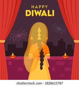 Back View of Indian Woman Standing at Window Curtain with Illuminated Oil Lamps (Diya) on Fireworks Background for Happy Diwali Celebration.