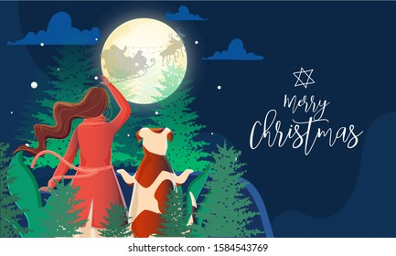 Back View of Woman and Dog Watching Santa Riding Reindeer Sleigh on Forest Moon Night Blue Background for Merry Christmas Celebration.