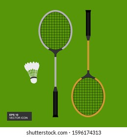Badminton racket and shuttlecock, vector illustration on a green background. An important badminton sport game equipment