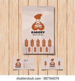 Bakery logo and business card vector template. Smiling baker with bread