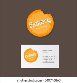 Bakery logo. Yellow bitten circle as bread on a dark background.
