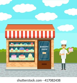 Bakery shop building facade. Sweet shop isolated on white and chef confectioner in uniform with cream cake.