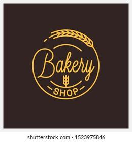 Bakery shop logo. Round linear logo of bakery wheat on black background