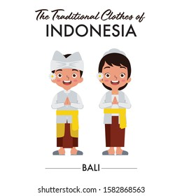 Balinese boy and girl are wearing Indonesian traditional clothes from Bali, Indonesia, as they saying welcome
