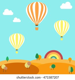 Balloons flying over the autumn landscape