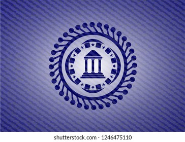 bank icon inside badge with denim background