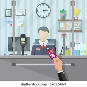 Bank teller behind window. Hand with bank card. Books, cup, plant, clocks, computer and keypad terminal. Depositing money in bank account. People service and payment. Vector illustration in flat style