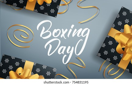 Banner with Boxing Day lettering text, glossy gift packages and realistic gold confetti.
